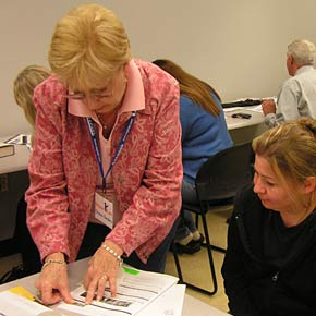 BIC co-founder, Sharon Sanders, assisting potential donor at a recruitment drive.